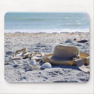 Hav strand, snäckor musmatta