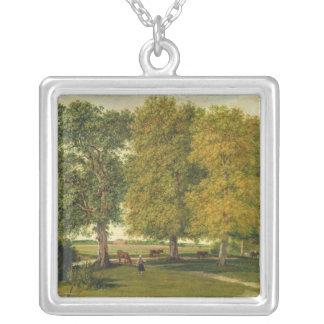 Herder med nötkreatur under höstliga träd silverpläterat halsband
