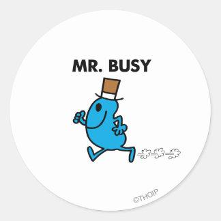 Herr upptaget spring snabbt runt klistermärke