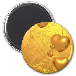Hjärta av den guld- magneten magnet
