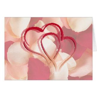 hjärtor och rosa petals hälsningskort