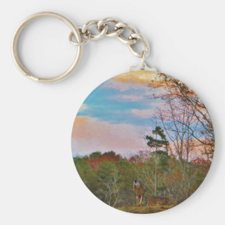 Hjort med en rosa blå himmel rund nyckelring