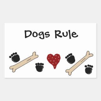 Hundar härskar - tass avtryck och ben rektangulärt klistermärke