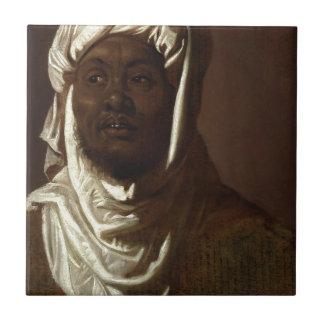 Huvud av en afrikansk man liten kakelplatta