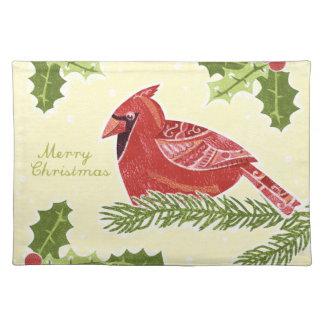 Huvudsaklig fågel för god jul på gren med järnek bordstablett