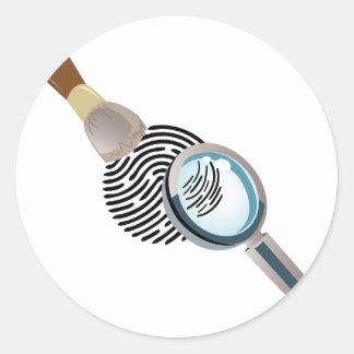 Identifiera med fingeravtryck runt klistermärke