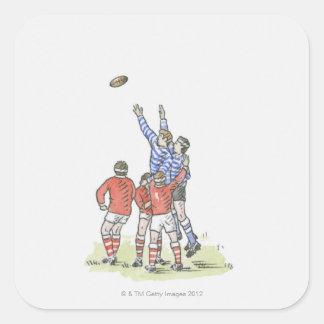 Illustration av manar som leker rugbybanhoppning i fyrkantigt klistermärke