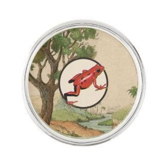 Illustration för livsmiljö för röd giftpilgroda kavajnål