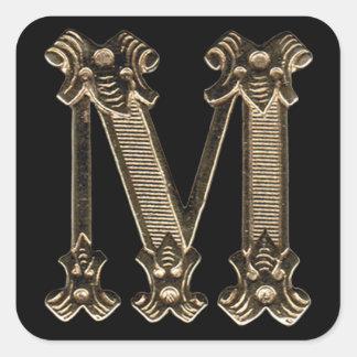 Initialt guld- brev M eller Monogram på svart Fyrkantigt Klistermärke