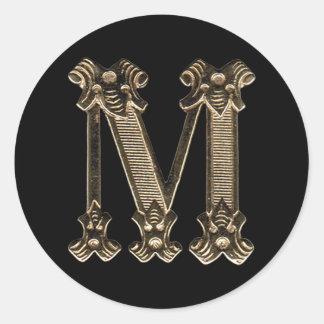 Initialt guld- brev M eller Monogram på svart Runt Klistermärke