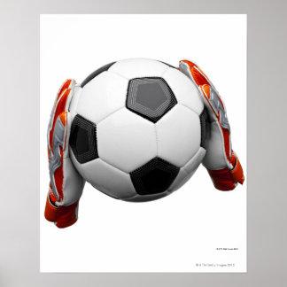 Innehav för två målvårdarehandskar en fotboll poster