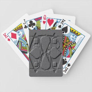 Inristade grått spelkort