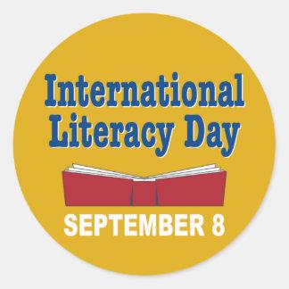 Internationell läs-och skrivkunnighetdag runt klistermärke
