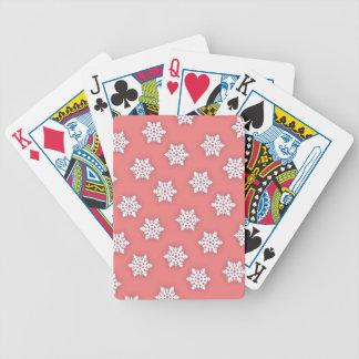 Invecklad snöflingor mot mjuka rosor spelkort