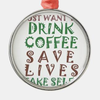 Jag önskar precis att dricka kaffesparaliv och att rund silverfärgad julgransprydnad