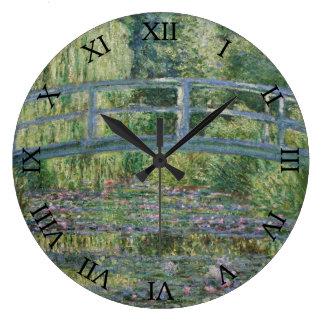 Japanen överbryggar och näckrosor vid Claude Monet Stor Klocka