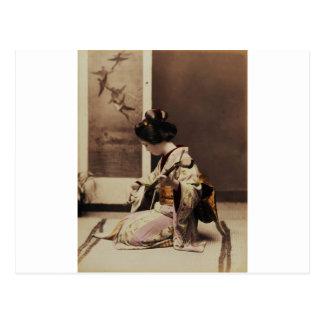 Japansk geisha som leker shamisenen vykort