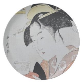 Japansk kvinna med Tea Tallrik