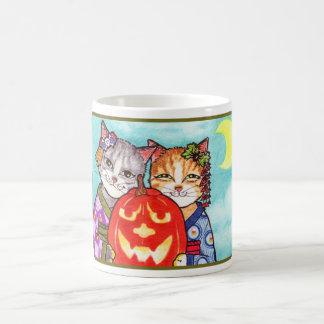 Japanska katter med nohpumpa muggar