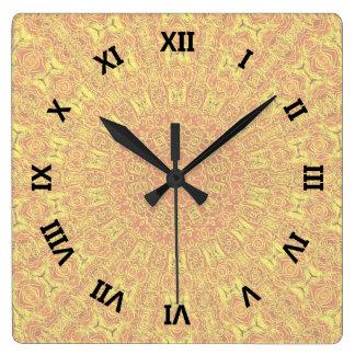 JORDinslag drar upp konturernaa av mönster Fyrkantig Klocka