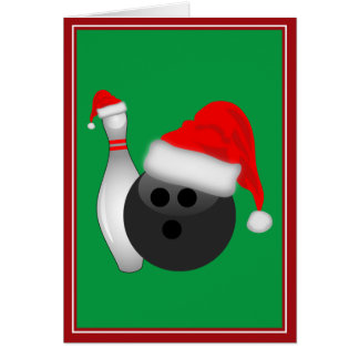 Julbowlingklotet och klämmer fast hälsningskort