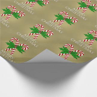 Julcandy cane och järnek som slår in papper 2 presentpapper