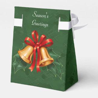 Julen sätta en klocka på och järneklövgrönt presentaskar