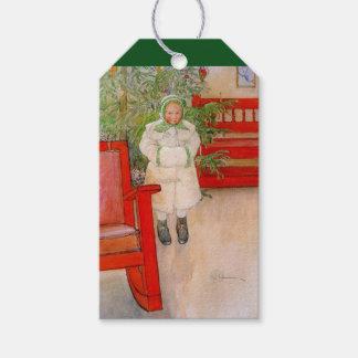 Julgran och barn i päls presentetikett