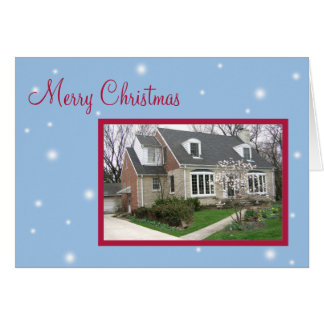Julhälsningar den snöig blåttjulen för hälsningskort