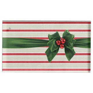 Julpilbåge med stripeybakgrund bordskorthållare