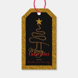 Julsvart och abstrakt julaftonträd för guld presentetikett