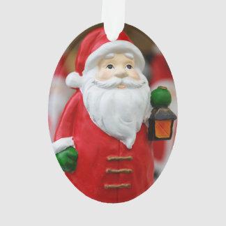 Jultomten med en lyktajuldekoration