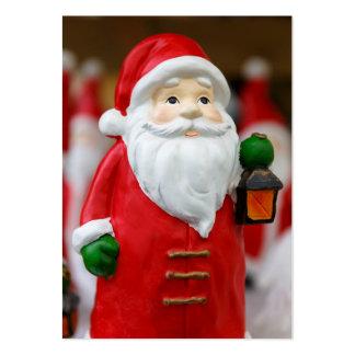 Jultomten med en lyktajuldekoration set av breda visitkort