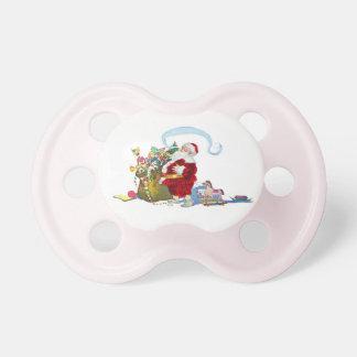 Jultomten med säcken av leksaker barn napp