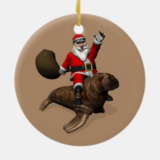 Jultomten rider en valross julgransprydnad keramik