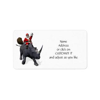 Jultomten som rider på noshörning adressetikett