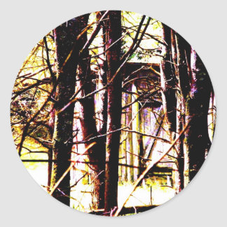 Kabin i skogen runt klistermärke
