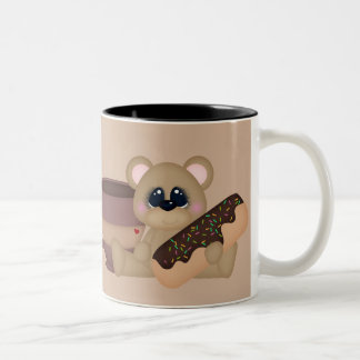 Kaffe och rolig mugg för donuts