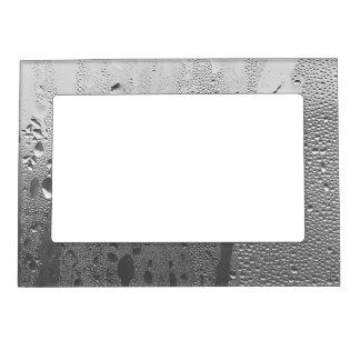 Kall kondensation på rostfritt stål magnetisk fotoram