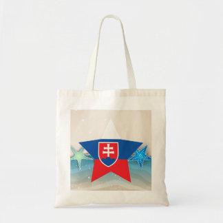 Kall Slovakien flagga på stranden Tygkasse