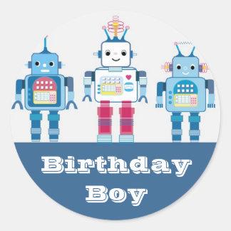 Kalla blått och röda robotnoveltygåvor runt klistermärke