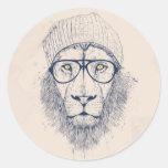 Kallt lejont runt klistermärke