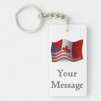 Kanadensare-Amerikan som vinkar flagga