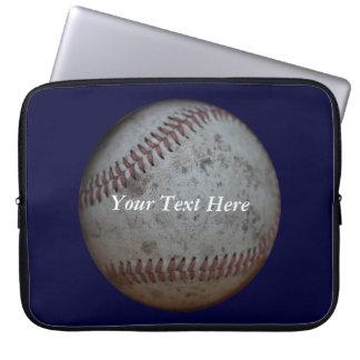 Känd baseball som är marinblå och laptop fodral