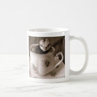 Kängor i en Teakopp Kaffemugg