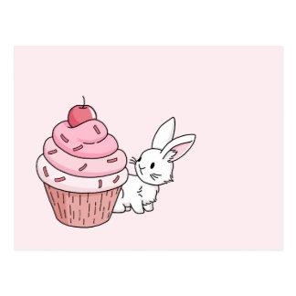 Kanin med en rosa muffin vykort