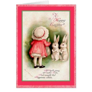 Kaniner för för vintagepåskflicka och vit hälsningskort