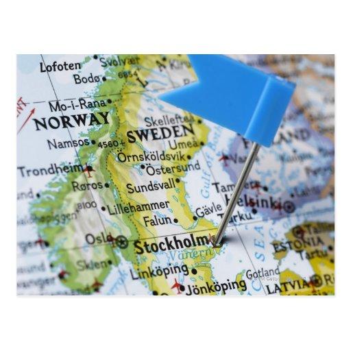 Kartan klämmer fast förlagt på Stockholm, sverige  Vykort