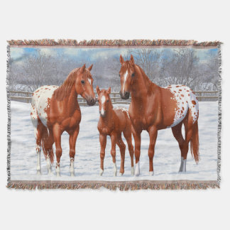 Kastanjebruna Appaloosahästar i snö Filt