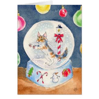 Katt i ett kort för snöjordklothälsning
